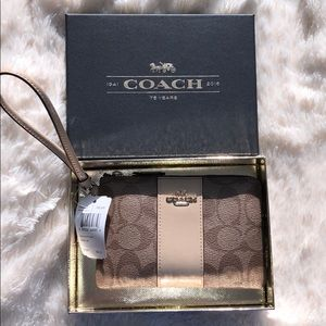 New Coach wrist wallet with tags and original box